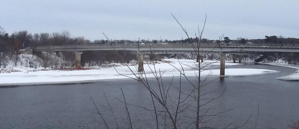 view of bridge over river in winter