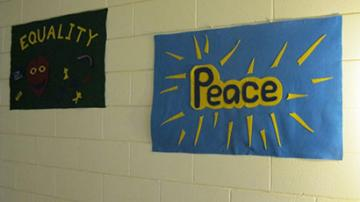"felt signs saying ""Equality"" and ""Peace"""